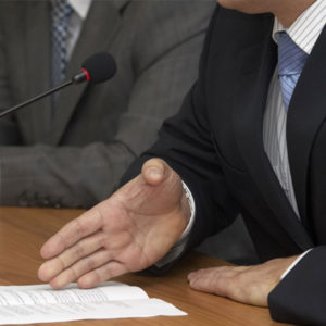 Lawyer speaking to the microphone during a dispute resolution