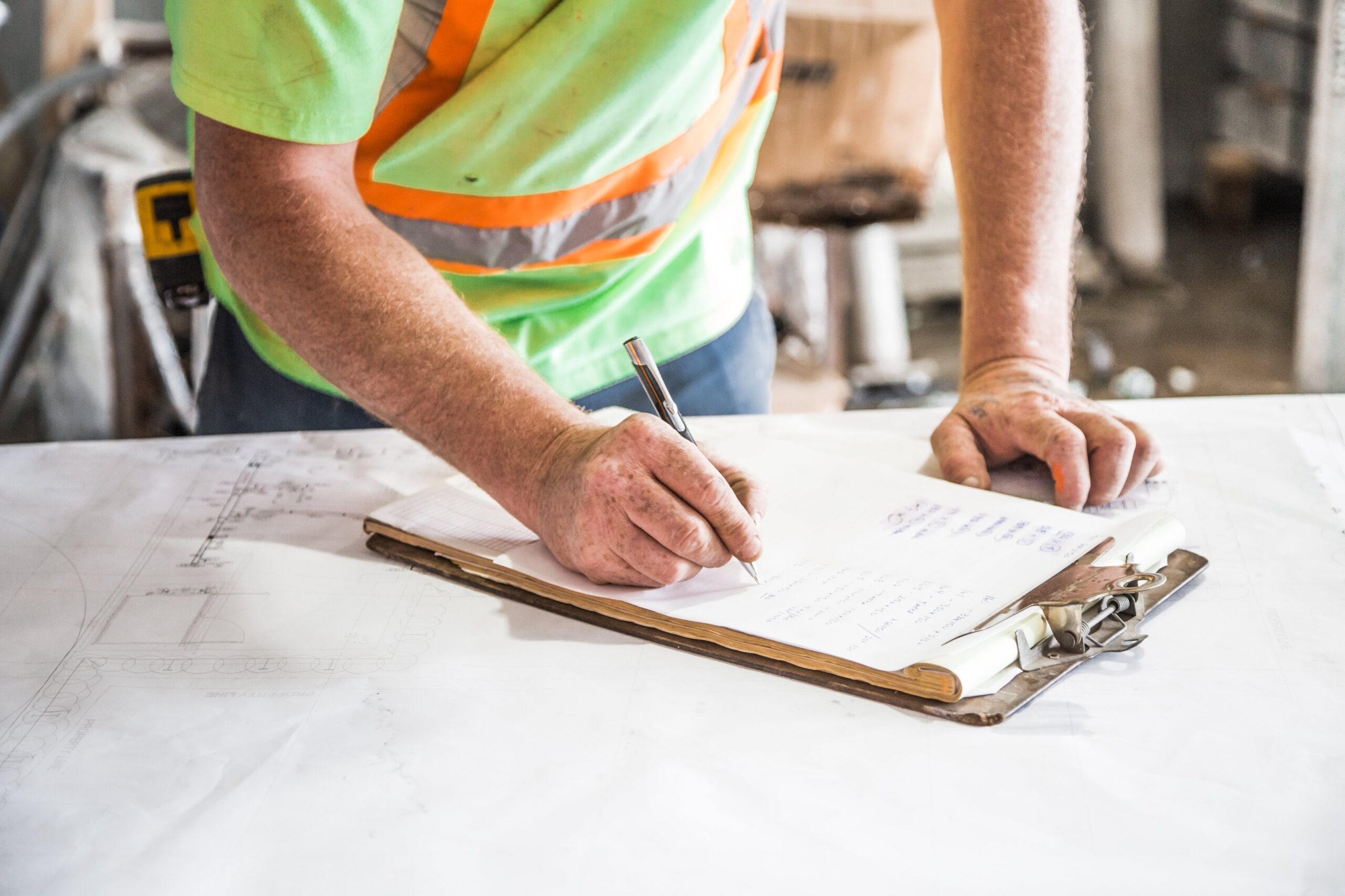 Construction employee checking a list