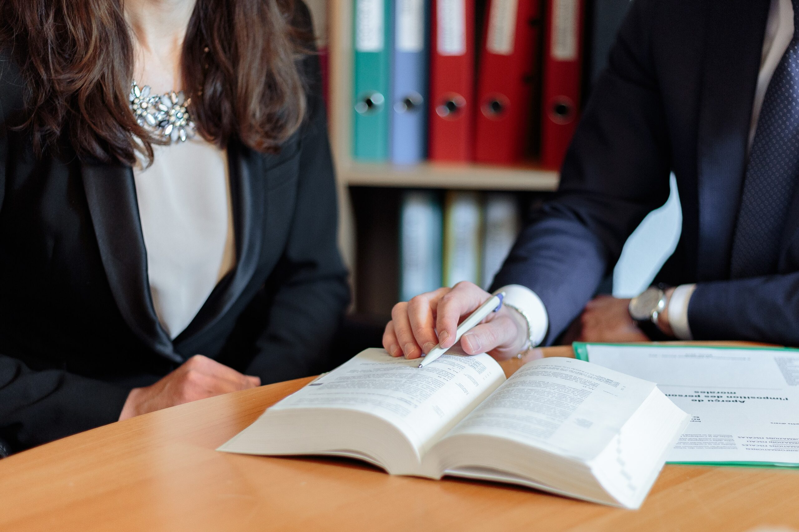 Lawyer pointing at a specific part of a book